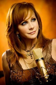 If she looks familar, well it may very well be because it is our beloved  Country Songstress/Actress Reba McEntire!!!